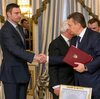 Ukrainian President Viktor Yanukovych (right) and opposition leader Vitali Klitschko shake hands Friday after signing an agreement that diplomats hope will end the bloodshed in Kiev.
