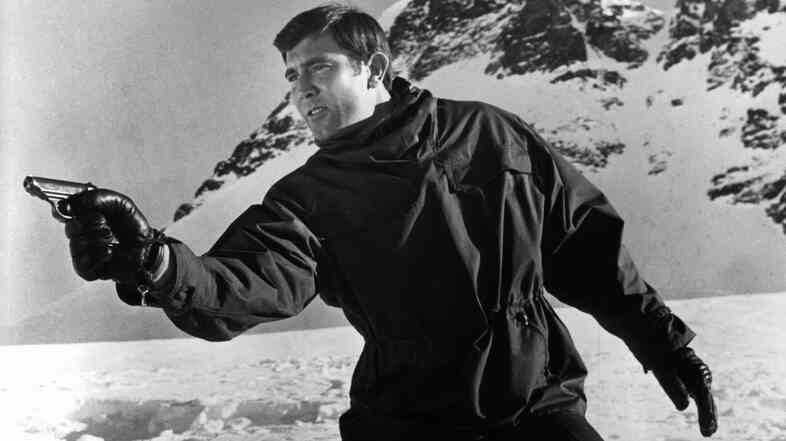 George Lazenby takes aim at his pursuers in a scene from the 1969 film On Her Majesty's Secret Service.