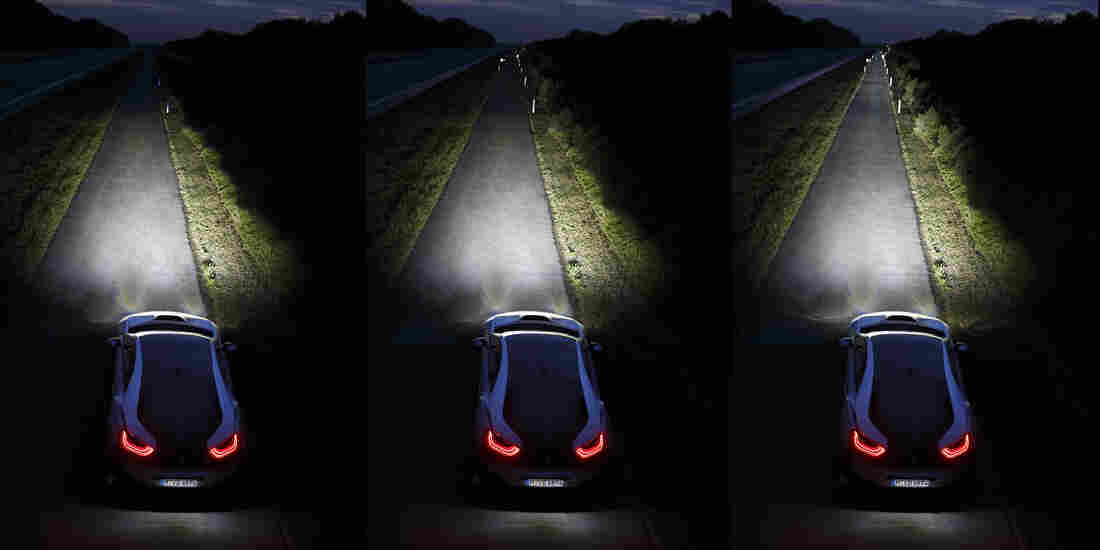 The BMW laser headlights (far right) are brighter than even LED headlights (left: low beam; center: high beam)