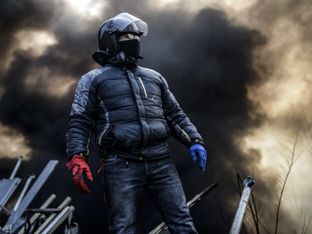 Even as word was emerging about a possible end to the crisis, anti-government protesters remained in Kiev's Independence Square early Friday.