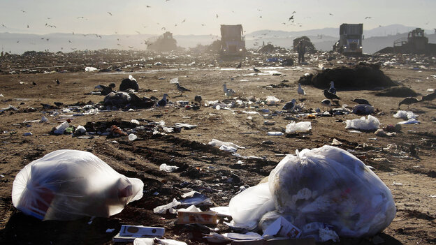 Trucks dump trash at the Puente Hill Landfill in Puente Hills, Calif., on October 31, 201
