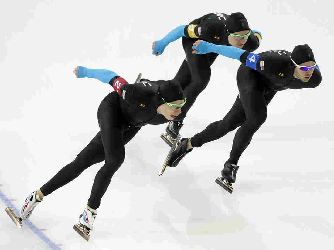 Speedskaters from the U.S., Brian Hansen (from left), Jonathan Kuck and Joey Mantia, compete in the team pursu
