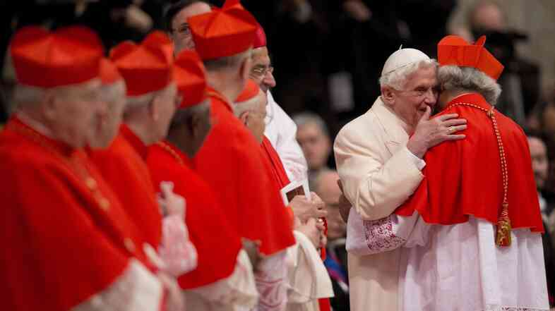 Newly-elected Cardinal Leopoldo Jose Brenes Solorzano, Archbishop of Managua, right, is hugged by Pope Emeritus Benedict XVI during a consistory inside the St. Peter's Basilica at the Vatican, on Saturday.