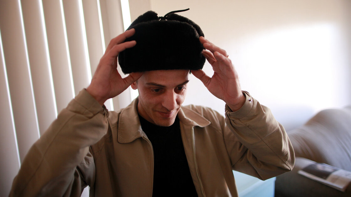 Izidor Ruckel dons a hat of a style common in his birthplace, Romania. He now lives in Denver.
