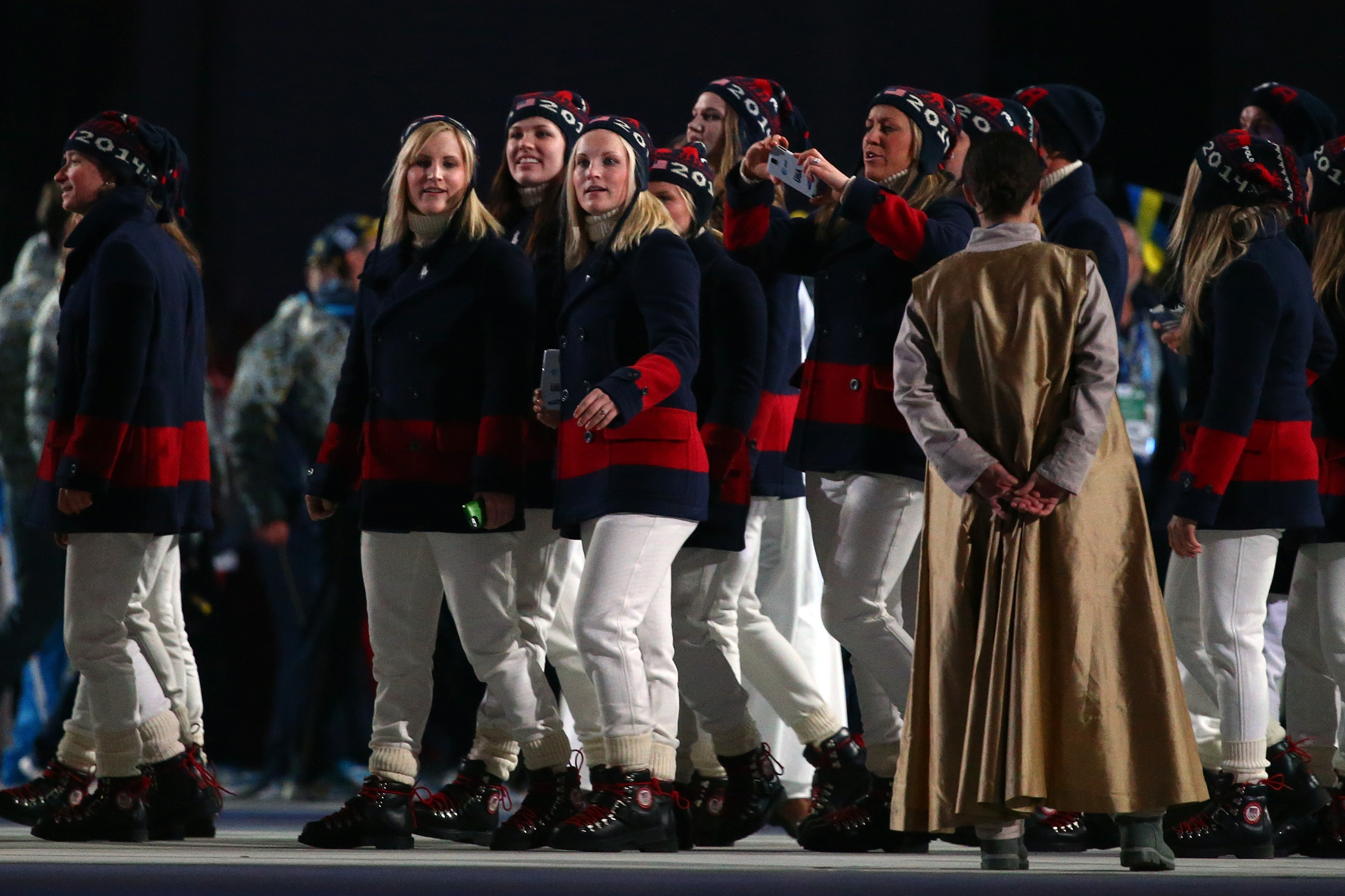 "U.S. athletes' outfits are a step up from their opening ceremony digs. NPR's Tamara Keith tweets: ""Ugly Christmas sweaters replaced by tasteful blue and red coats."""