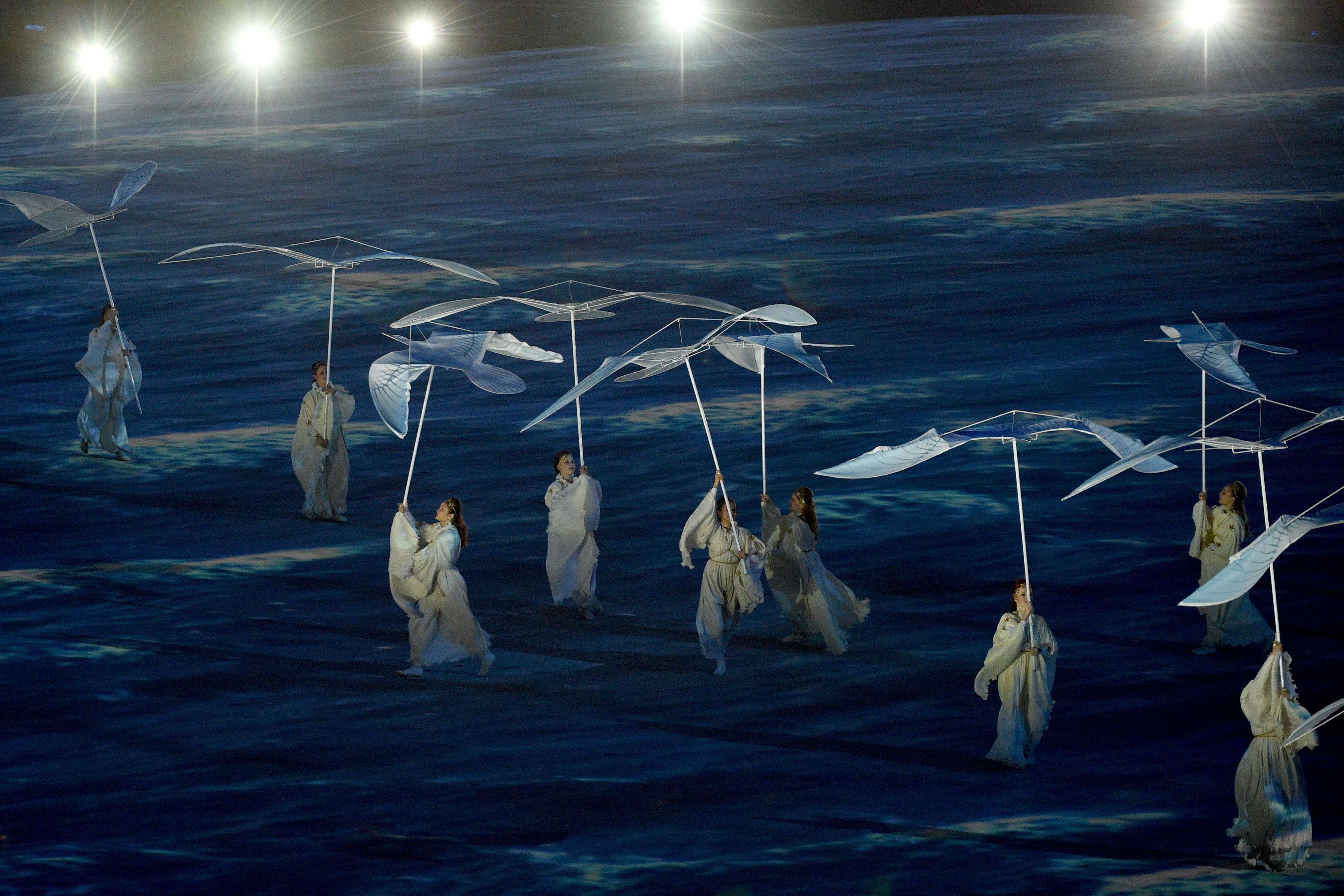Performers take the spotlight in Sochi's Fisht Stadium.