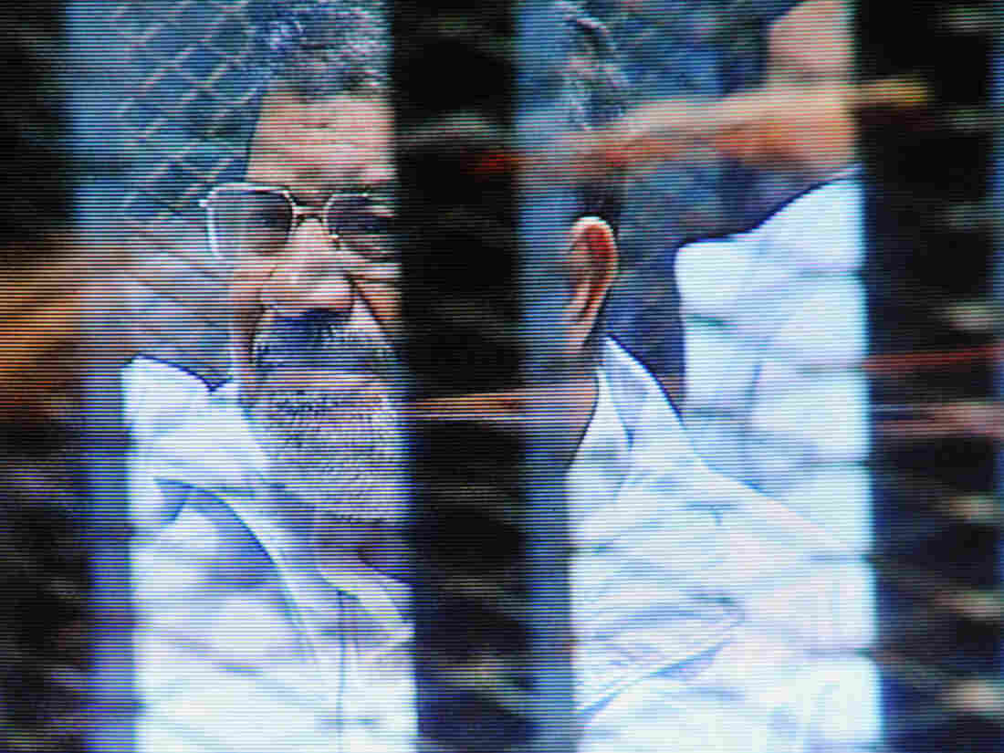 Egypt's ousted President Mohammed Morsi in a soundproof barred glass cage is seen during a court appearance on Feb. 16.