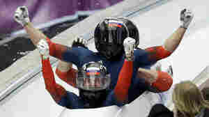 The team from Russia RUS-1, with Alexander Zubkov, Alexey Negodaylo, Dmitry Trunenkov, and Alexey Voevoda, celebrate after winning gold during the men's four-man bobsled competition final at the 2014 Winter Olympics, on Sunday.
