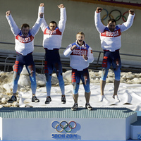 Russia RUS-1 bobsled team, with Alexander Zubkov, Alexey Negodaylo, Dmitry Trunenkov, and Alexey Voevoda, jump onto the medal stand after winning gold on Sunday. On the last day of the Sochi Games, Russia had already secured the top spot in the overall medal count.