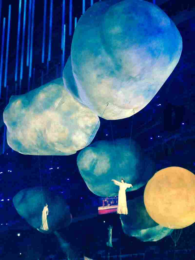 Performers fly above the crowd in Sochi during the closing ceremony of the Winter Olympics.