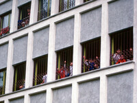 Children reach out from the windows of the orphanage in Sighetu Marmatiei in 1992.