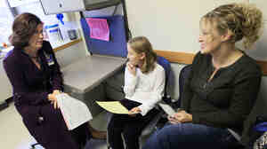 Joscelyn Benninghoff, 10, goes over the results of her cholesterol test with her mother Elizabeth Duruz (right) and Dr. Elaine Urbina at Cincinnati Children's Hospital in 2011.
