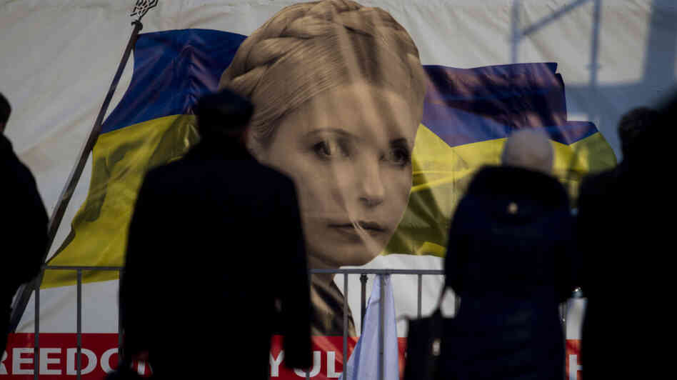 People pass by a portrait of prominent opposition leader Yulia Tymoshenko at Independence Square in Kiev, Ukraine, on Monday. Tymoshenko, a former prime minister, is one of the leaders who have emerged after the ouster of President Viktor Yanukovych, but she is also a controversial figure.