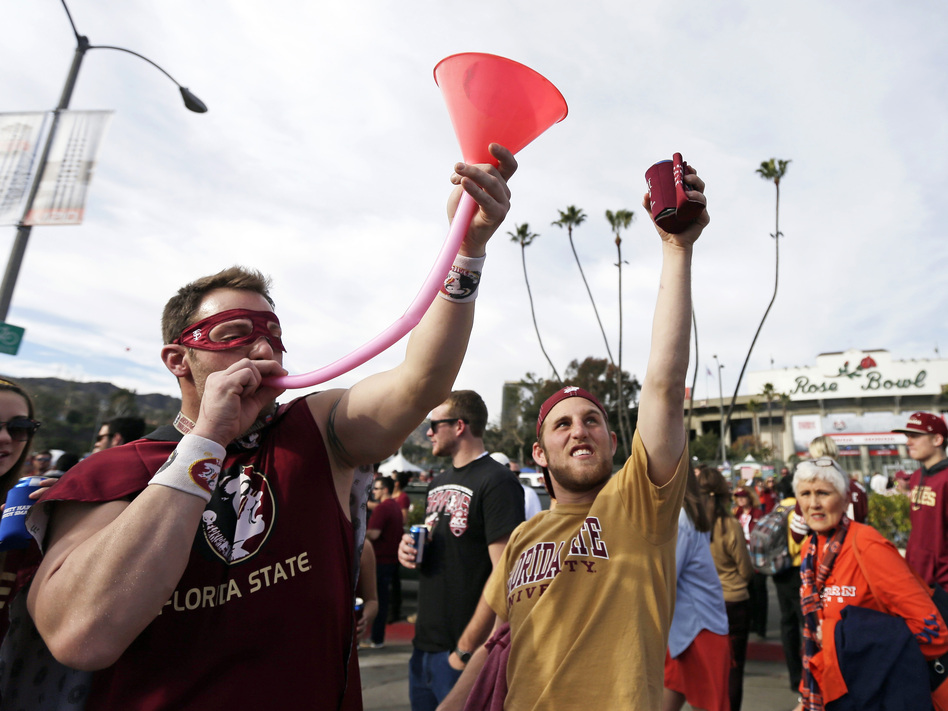 Students drink outside the Rose Bowl during the NCAA BCS national championship game in January. (Gregory Bull/AP)
