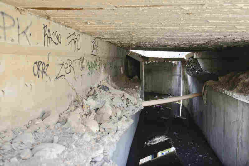 The opening to one of the many tunnels that authorities discovered were used by Guzman as escape routes. The neighborhood of La Libertad is known for its complex drainage system, which provided easy access in and out of various safe houses.