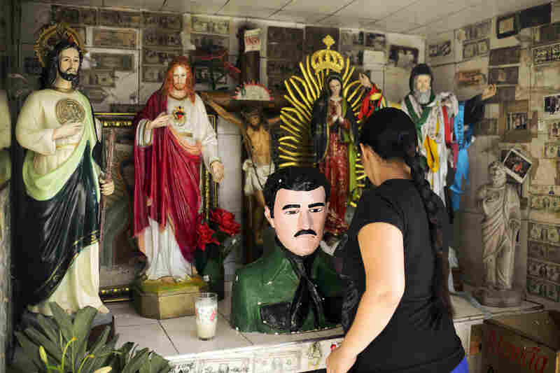"Attendee at the shrine of Jesus Malverde, an icon in Sinaloa. His existence is disputed but he is legendary in Mexico, and is said to have been a Robin Hood-like bandit who stole from the rich and gave to the poor. Although not officially recognized by the Catholic church, he is venerated as a saint, particularly in ""narco"" culture and in Sinaloa."