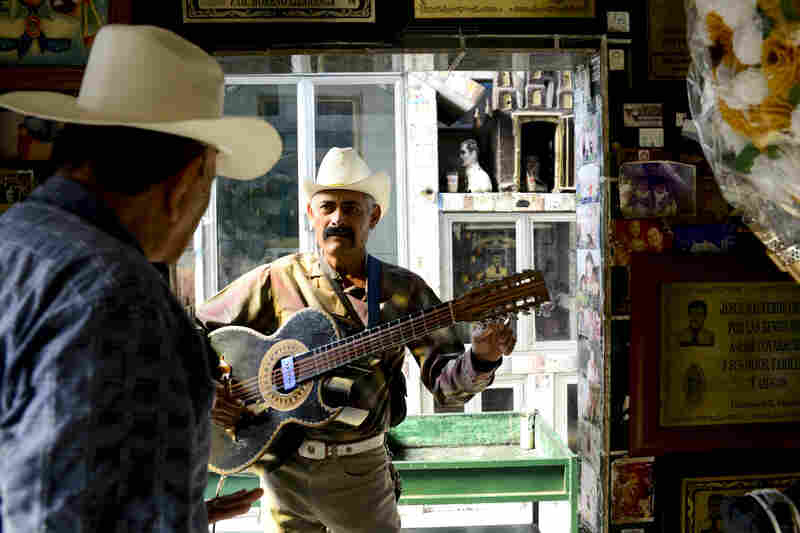 Mariachis playing at the shrine of Jesus Malverde.