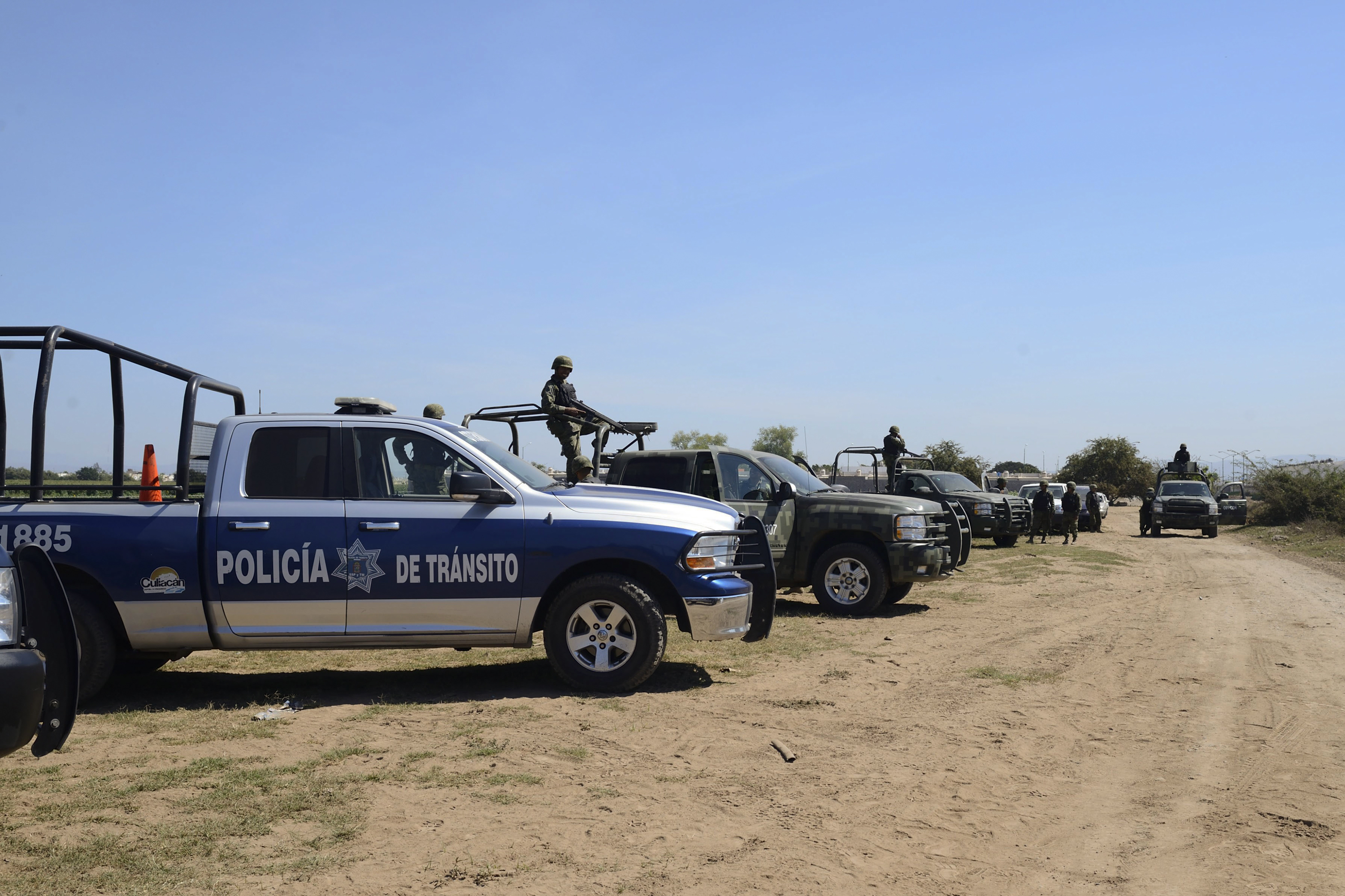 Federal police and marines encircle an area at the ranch Culiacan where they found the empty plastic cucumbers.