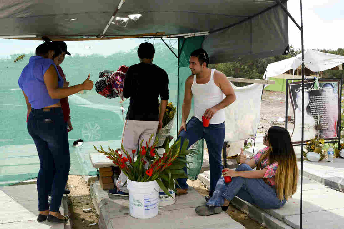 A group of youths spend a Sunday afternoon at their friend's tomb drinking and singing narcocorridos (ballads that celebrate the life and exploits of drug traffickers). Christina (right), a 21-year-old psychology student, says drug trafficking is a way of life in Sinaloa.