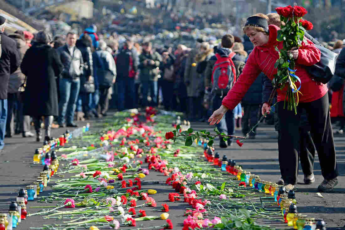 In Kiev's Independence Square, flowers have been left in memory of protesters killed there in recent days.