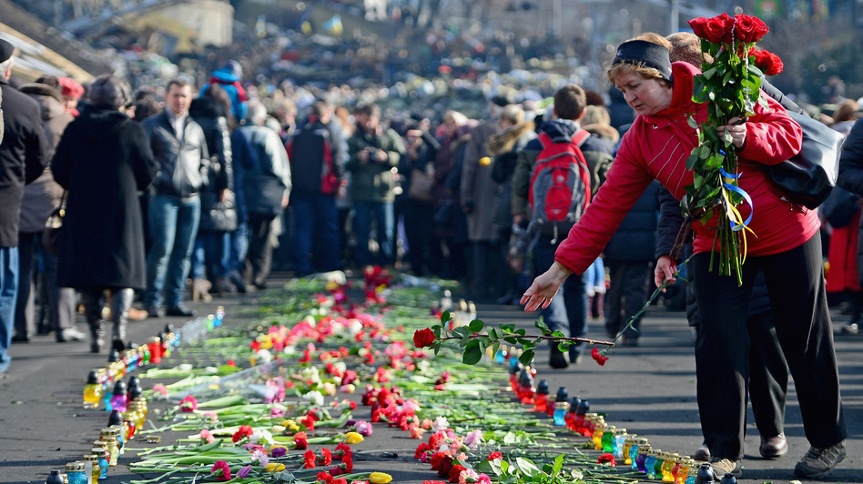 In Kiev's Independence Square, flowers have been left in memory of protesters killed there in recent days. (Getty Images)