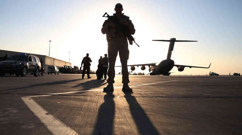 A U.S. soldier stands guard at the airfield in Kandahar, Afghanistan.
