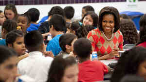 Michelle Obama eats lunch with school children at Parklawn Elementary School in Alexandria, Va., in 2012. The first lady unveiled new guidelines Tuesday aimed at cracking down on the marketing of junk food to kids during the sc