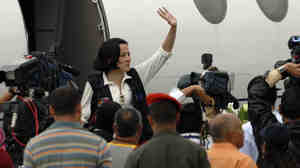 Clara Rojas waves as she arrives at an airport near Caracas, Venezuela, on Jan. 10, 2008, after being released from six years of captivity by Colombian rebels.