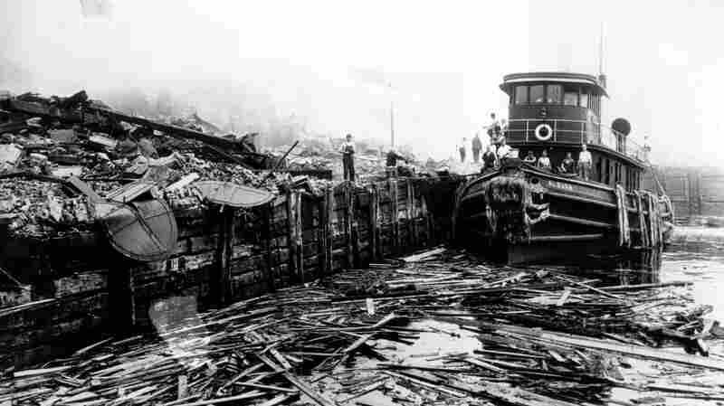 A fireboat sits amid ruins and debris on the piers at Black Tom Island in Jersey City, N.J., on July 30, 1916. Evidence pointed to German sabotage. In Dark Invasion, Howard Blum explores Germany's spy network and sabotage efforts in the U.S. at the beginning of World War I.