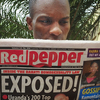 A man reads a copy of Red Pepper on Tuesday in Kampala, Uganda.
