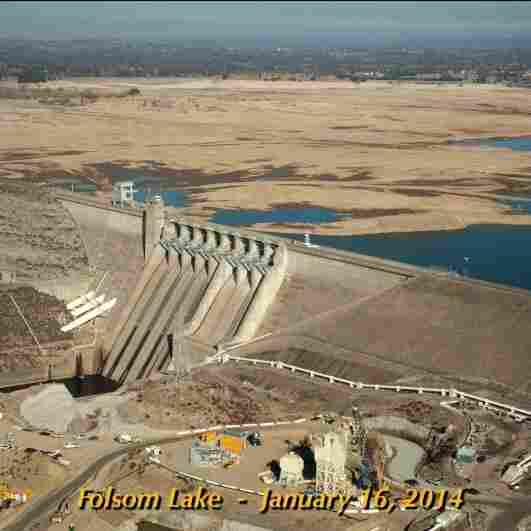 Images of Folsom Lake, a reservoir in Northern California, show the severity of the state's drought. The photo at left, taken on July 20, 2011, show the lake at 97 percent of total capacity and 130 percent of its historical average for that date. The photo at right shows the lake on Jan. 16, 2014, when it was at 17 percent of capacity and 35 percent of its historical average.