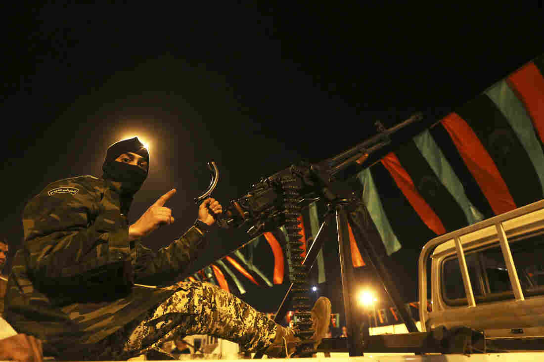 A member of a heavily armed militia group is seen with his weapon in Freedom Square in Benghazi, Libya, on Feb. 18. Many of the militias are actually on the government payroll.