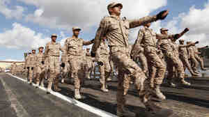 Soldiers march during a graduation ceremony for recruits of the Libyan army in Tripoli, the capital, on Jan. 16. The military, gutted by years under Moammar Gadhafi and by NATO attacks, faces multiple challenges as it tries to rebuild.