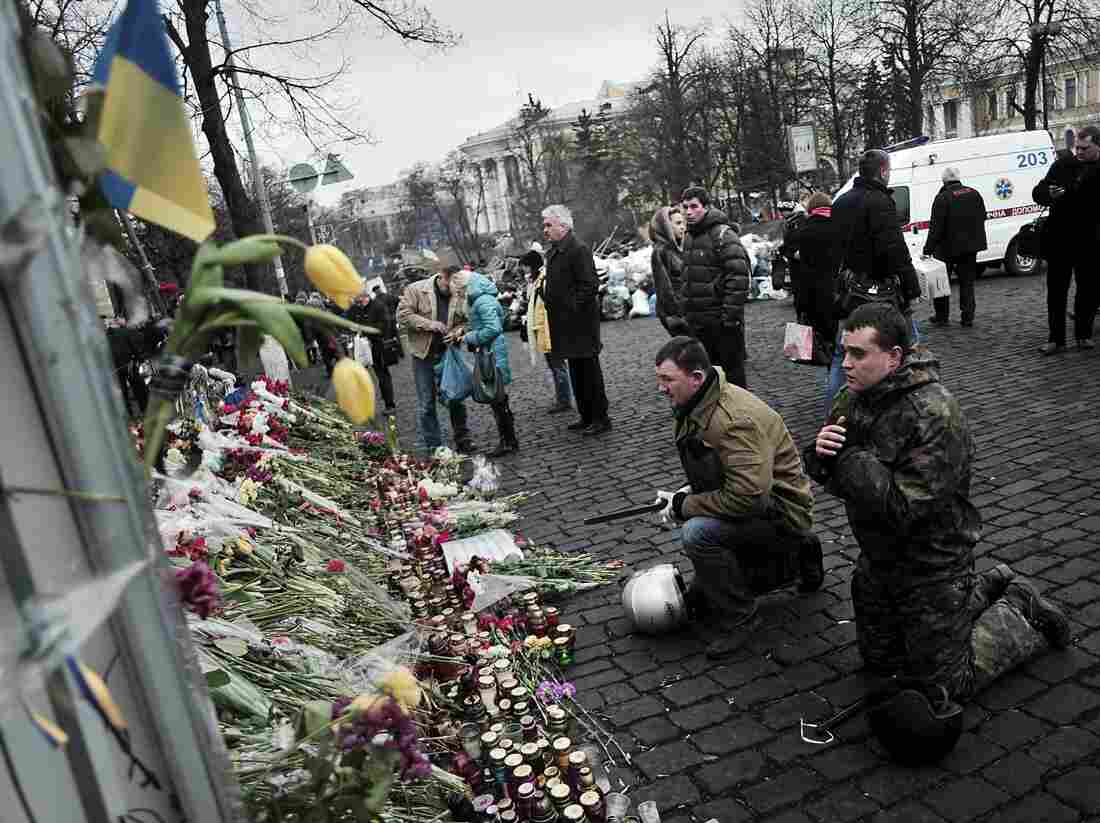 Praying For Those Who Died: Mourners were in Kiev's Independence Square again on Tuesday. It was the site of protests in recent months, and was where more than 80 people died last week in violence blamed on security forces.