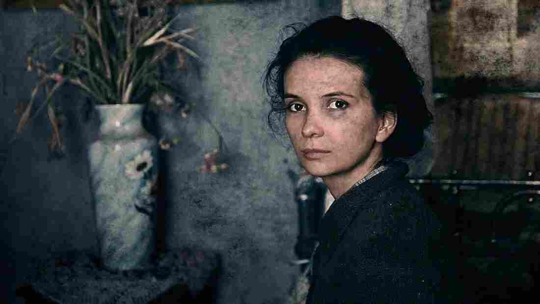 Teenage civilian Katya (Mariya Smolnikova) shares a ruined apartment with a gang of Soviet soldiers during the battle of Stalingrad in Fedor Bondarchuk's Stalingrad.
