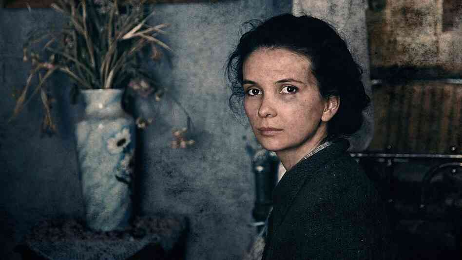 Teenage civilian Katya (Mariya Smolnikova) shares a ruined apartment with a gang of Soviet soldiers during the battle of Stalingrad in Fedor Bondarchuk's Stalingrad.