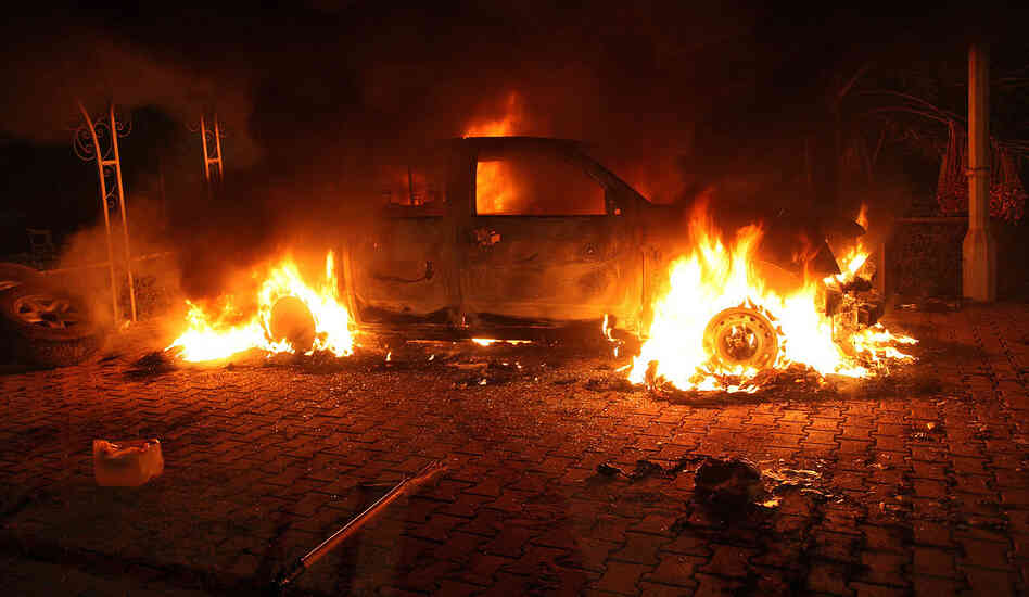 "A vehicle inside the U.S. Consulate compound in Benghazi is engulfed in flames after an attack on Sept. 11, 2012. ""There is no evidence whatsoever that al-Qaida or any group linked to al-Qaida played a role in organizing or leading the attack,"" says New York Times correspondent David Kirkpatrick."