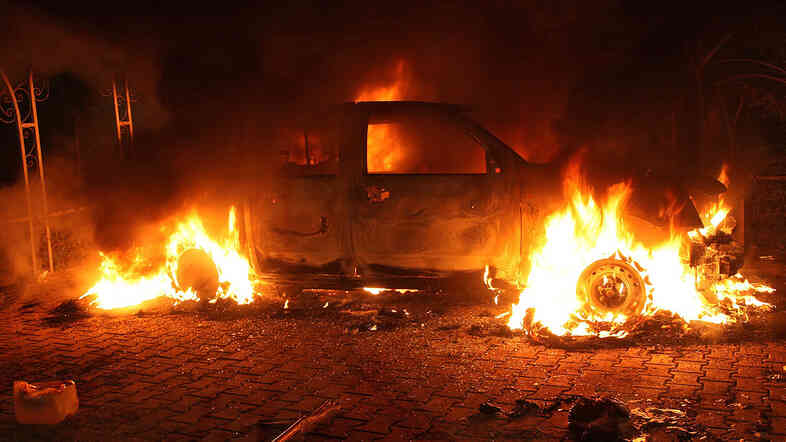 """A vehicle inside the U.S. Consulate compound in Benghazi is engulfed in flames after an attack on Sept. 11, 2012. """"There is no evidence whatsoever that al-Qaida or any group linked to al-Qaida played a role in organizing or leading the attack,"""" says New York Times correspondent David Kirkpatrick."""