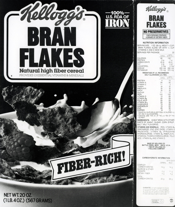 This 1986 Kellogg's Bran Flakes box lists many attributes: 100% RDA of Iron, Fiber Rich, No preservatives, natural high fiber cereal, provides 13 essential vitamins and minerals. Under the 1990 Nutrition Labeling and Education Act, many confusing label terms began to be standardized.