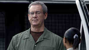 Texas tycoon R. Allen Stanford, who conned investors in a $7 billion Ponzi scheme, arrives in custody at the federal courthouse for an Aug. 2010 hearing in Houston.