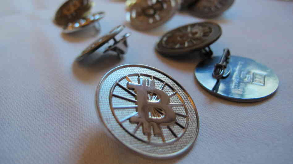 No, these aren't real bitcoins (just Bitcoin buttons). Fans of the virtual currency see several real benefits, including the elimination of fees for transferring money.