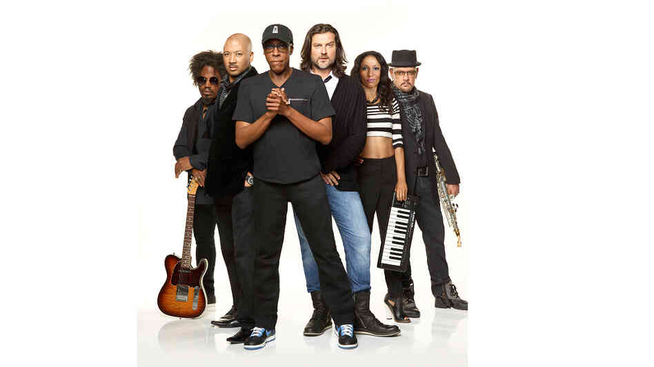 Arsenio Hall with his band. Robin DiMaggio stands to the right of Arsenio.