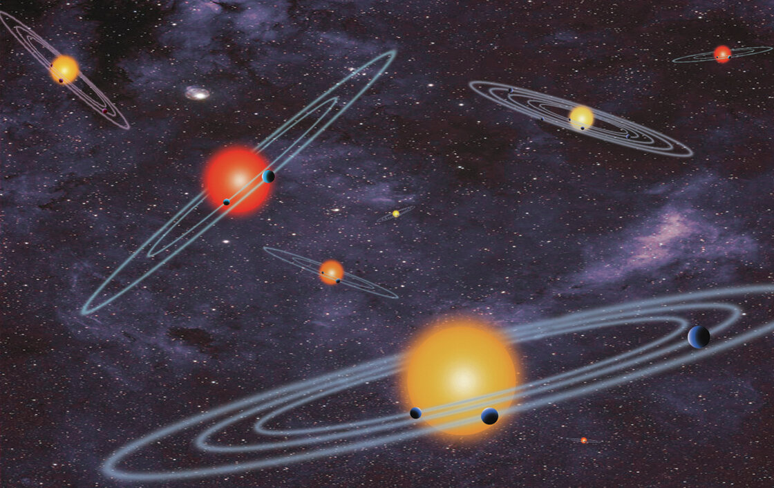 An artist's rendering released by NASA Wednesday shows multiple-transiting planet systems, which are stars with more than one planet. The agency unveiled the discovery of 715 verified exoplanets today.