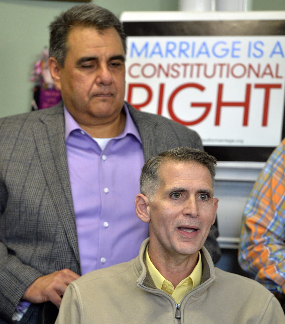 Greg Bourke, front, and his partner Michael Deleon speak to reporters following the announcement from U.S. District Judge John G. Heyburn striking down part of Kentucky's same-sex marriage ban.