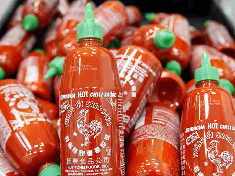 Sriracha chili sauce bottles are produced at the Huy Fong Foods factory in Irwindale, Calif.