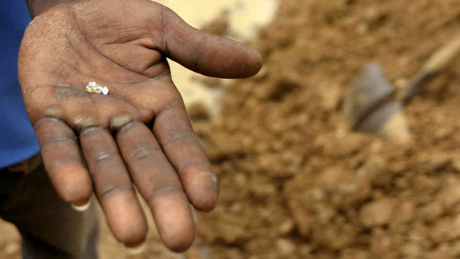 A villager holds diamonds dug out from a mine outside the village of Sam Ouandja in northeast Central African Republic in 2007.
