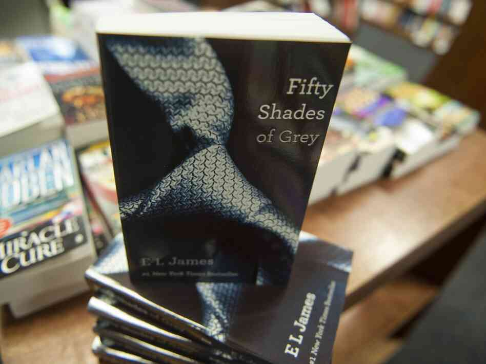 Copies of Fifty Shades of Grey by E. L. James at th