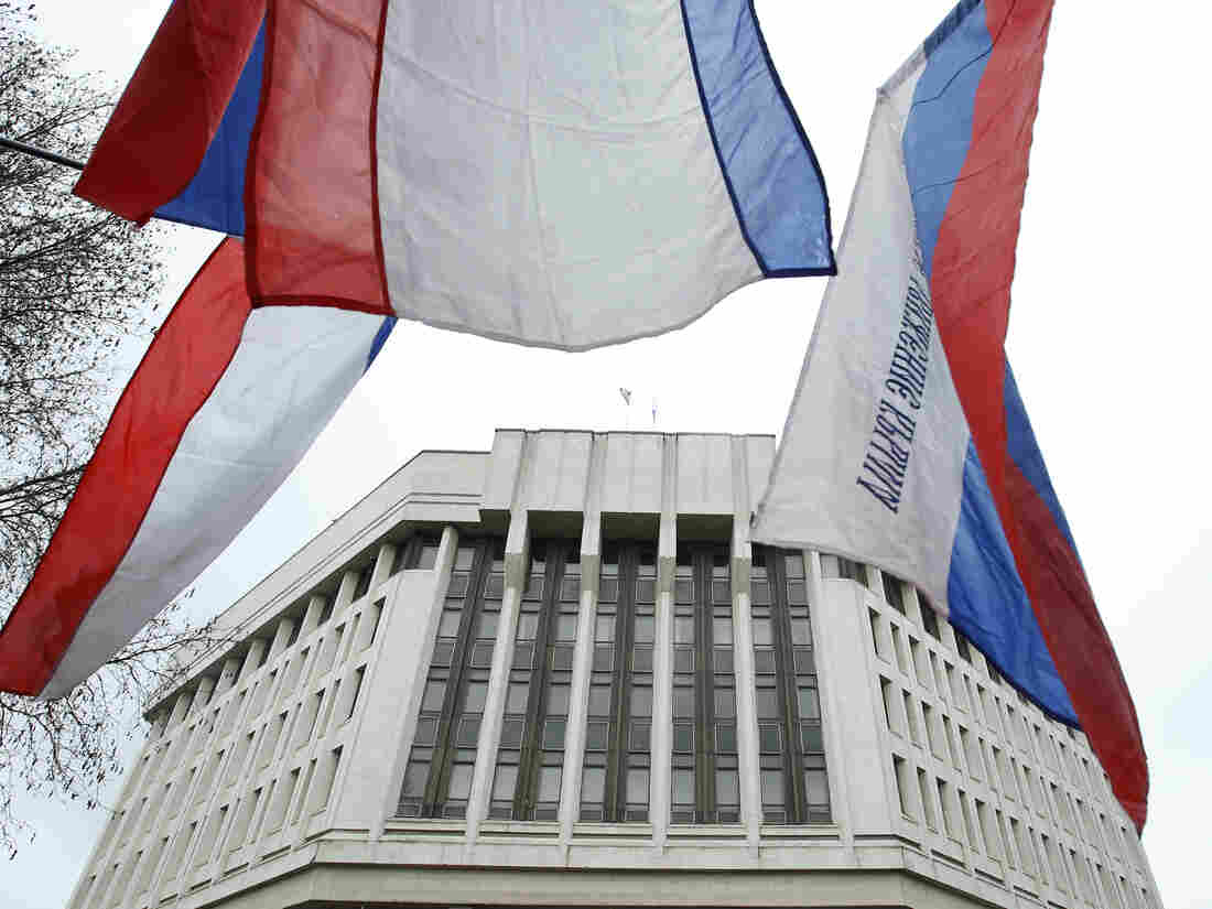 Flags fly outside the Crimean parliament building in Simferopol on Thursday during a rally by pro-Russian protesters. Gunmen seized government build
