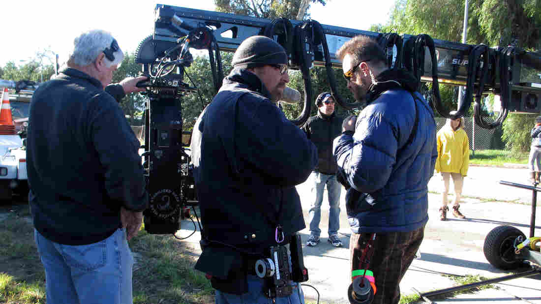 "On location for Walk of Shame, camera crew members Larry Nielsen (center) and Milan ""Miki"" Janicin (right) help set up a crane shot. The wireless focus remote Nielsen will use is hanging from that purple carabiner on his jacket."