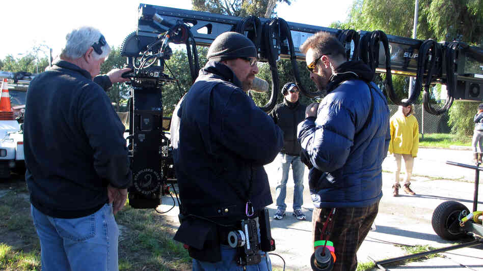 """On location for Walk of Shame, camera crew members Larry Nielsen (center) and Milan """"Miki"""" Janicin (right) help set up a crane shot. The wireless focus remote Nielsen will use is hanging from that purple carabiner on his jacket."""